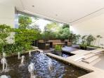 Enjoy the cool breeze  in the Zen garden with fountains and fish pond