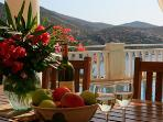 outside dining for 10 by the pool with panoramic sea and mountain views