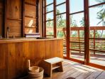 Japanese-inspired teak soaking bath in upstairs bathroom, overlooking the ocean