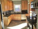 Brand new modern kitchen with all of the cookware & utensils you'll need