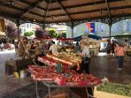 Fresh fruit and produce, cheeses, local crafts at the farmer's market.