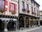 The medieval main square in Mirepoix is a two minute walk from Le Tardis.