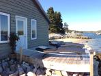 Waterfront deck with loungers