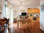 Spacious dining area and fully equipped kitchen at maisonette