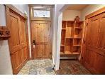 Entry way.  From left to right:  Closet door, front door, cubbies for stuff, then garage door.