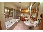 Master Bath.  Two pedestal sinks, jetted tub, big shower, separate toilet room. Storage galore!