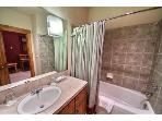 Full bath off of upstairs hallway has lots of storage, and washer and dryer around the corner!