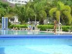 Crystal clear swimming pool with well maintained gardens