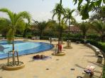 Very pleasant modern swimming pool areas to relax in the sun