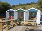 Talland Bay Beach Cafe - enjoy a Cornish Cream Tea or pasty in your own pretty beach hut!