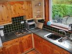 Luxury fitted kitchen with oven, hot plate, microwave, fridge, dishwasher and washing machine