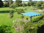 The pergola and our garden seen from the gite stairs