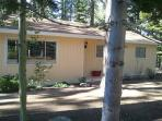 Front of house w/ natural landscaping. Drive way and 1 car garage & ample parking for 2 addt'l cars