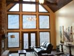Walls of windows fill the home with light
