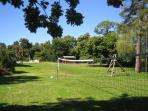 Grounds - volley-ball & badmington net with rope swing behind.