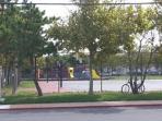 playground and basketballs courts 1 block away