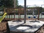 Playground with Tennis Court in background