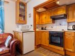 Kitchen with cooker halogen hob, fridge, microwave and all utensils