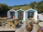 Enjoy a lovely lunch at Talland Bay Cafe, in one of their beautiful Beach Huts.