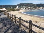 Wooden board walk behind beach into Le Lavandou- perfect for evening stroll