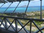 View from the spacious verandah looking at Petit Martinique and the  azure blue bay