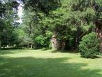 View of the peaceful back yard with the old pigeonnier (pigeon tower)