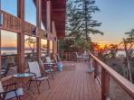 Outdoor seating on wrap around decking. Decks on all 3 levels. Gorgeous sunsets and view of Canada.