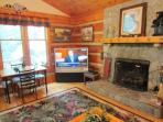 Living Room with Stacked Stone Fireplace, Flat Screen and Game Table