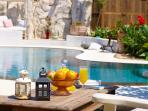 Outdoor area by the pool, ideal for relaxation!