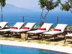The Villa's stone paved terrace enjoys breathtaking views of natural beauty, panoramic sea view and