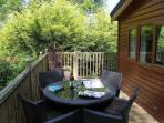 private sunny decking area for alfresco dinning, with distant view to lake windermere on a clear day