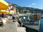 Enjoy dining in one of the many quayside restaurants in Villefranche