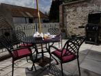 The south facing courtyard patio area complete with barbecue facilities.