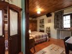 accogliente e calda camera con bagno privato