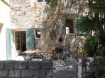 terrasse cuisine et chambre voûtée rez-de-chaussée