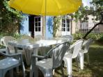 Outdoor dinning in private garden area.  You also have use of the pretty communal gardens.