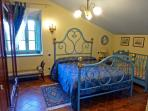 The Blue Bedroom with baby-cot.