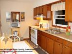 Completely furnished kitchen with stove, refrigerator, microwave, coffee pot, toaster, etc.