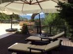 The wooden deck by the pool