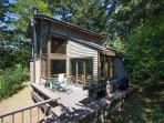A home filled with peace and tranquility, set in the woods by th