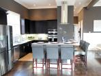 Amazing Chef's Kitchen Featuring Gas Range, 2 Ovens, Marble Counters, Bar seating for 6.