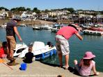 Holiday makers crabbing off the harbour