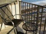 2 sling chairs and a table...  over looking the ocean and.... see next pictures for view
