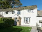 Orchard Cottage is situated in pretty gardens just a short walk to two beaches.