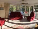 Lounge with 2 sets patio doors to veranda, ceiling fan and door to hall.180 degree views.