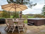 Relax on the solid teak garden furniture let the River Dee glide by