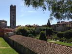 view from the Lucca Walls on San Frediano's belfry and on Palazzo Pfanner