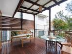 Covered deck with Daybed and outdoor dining