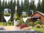 Enjoy a wine overlooking paddocks to the mountains