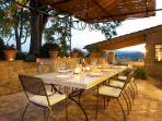 Kitchen terrace with stone dining table seating 10 -12 people